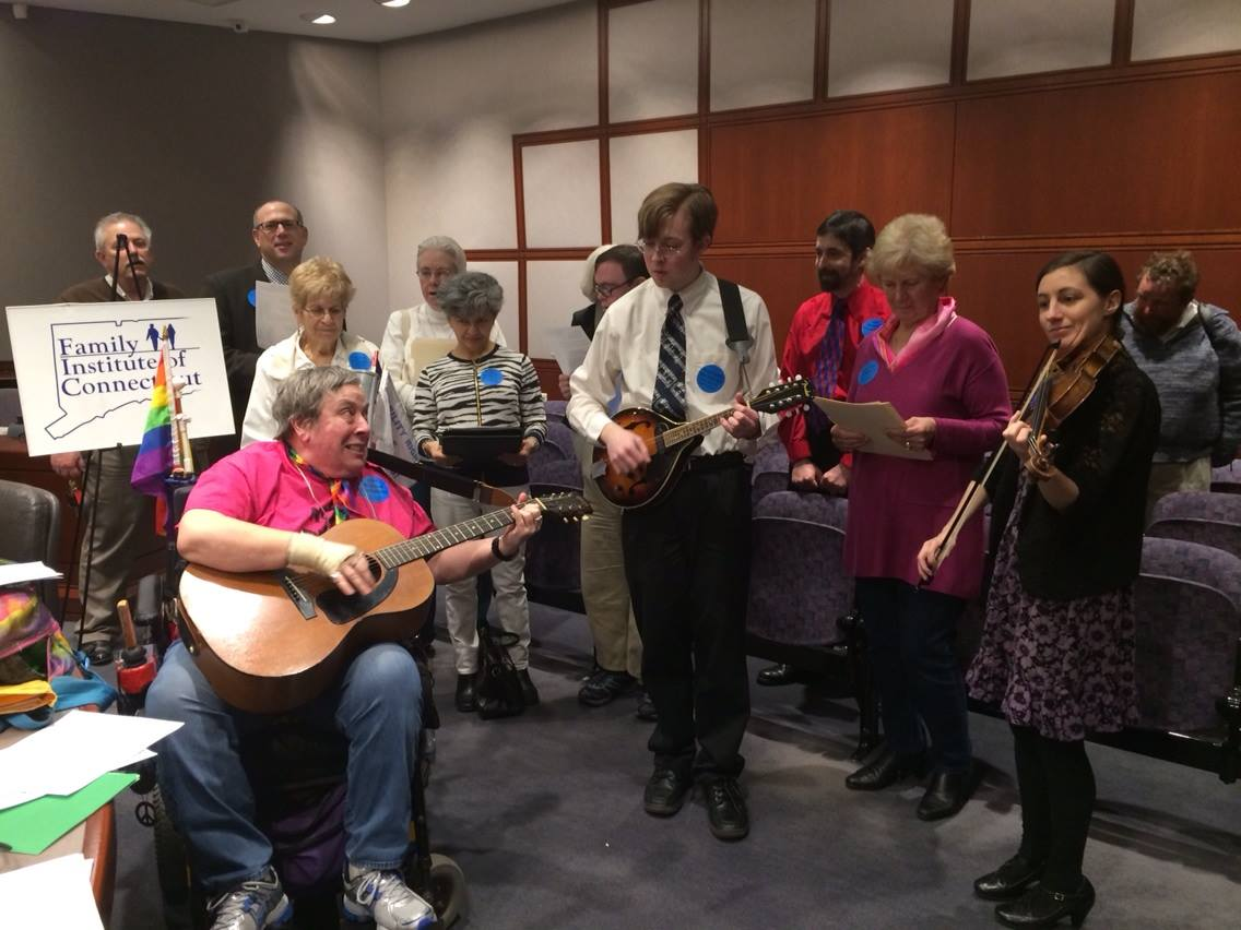 Opponents to assisted suicide take a break to jam at the state Capitol.