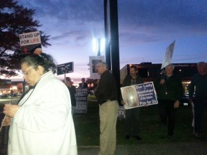 Peter Wolfgang addresses crowd at dusk