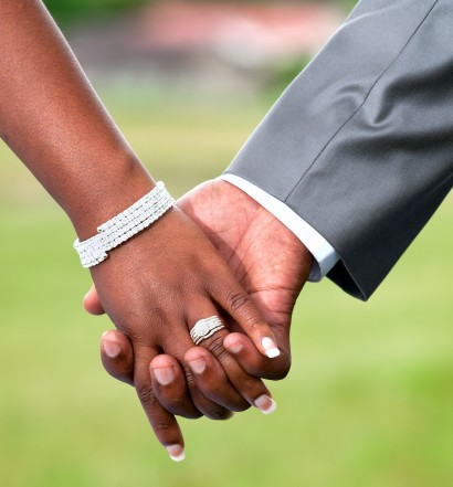 Cropped view of an African Couple's hands at their Wedding. Wide Aperture Used.