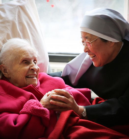 One of the Little Sisters of the Poor caring for an elderly woman. (The Becket Fund for Religious Liberty)